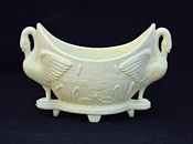 Sowerby glass ivory Queensware, swan flower-holder with lilies and bullrushes